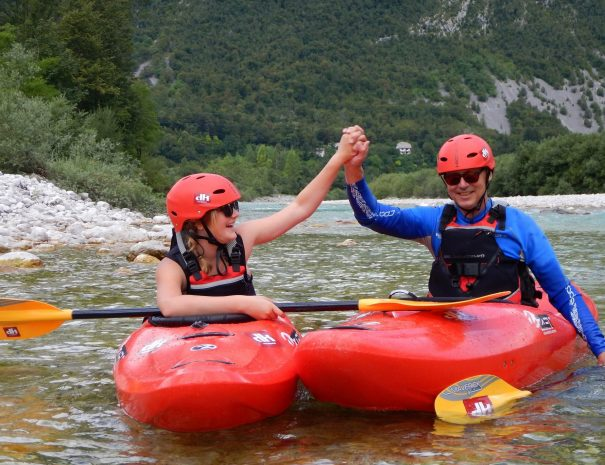 father and daughter high five after good kayak lesson on soča