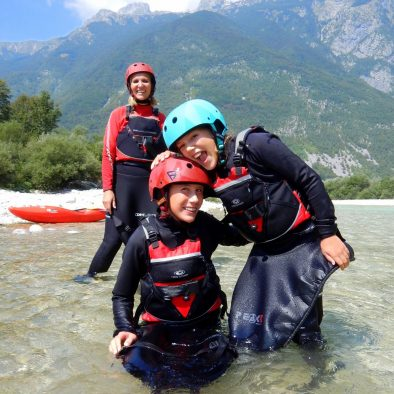 brother and sister are having great time kayaking on soča