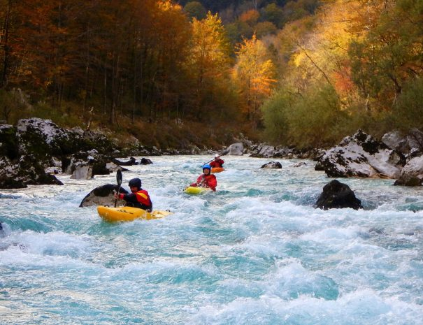 friends having good time in autumn kayaking soča valley rivers