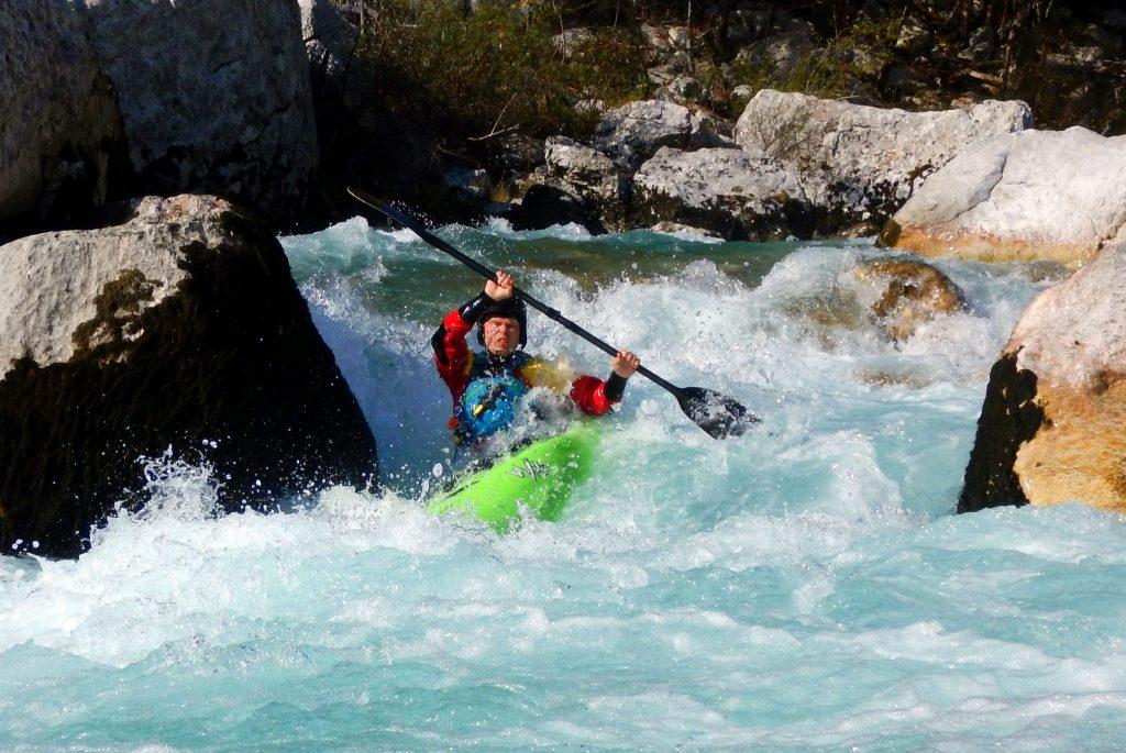 advanced kayaker on otona section of soča river