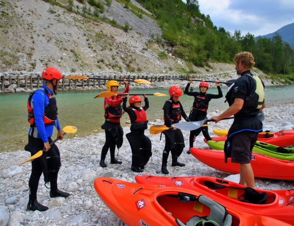 french family is starting to learn kayak on soča river