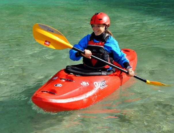Happy women kayaking the Soča river in Slovenia
