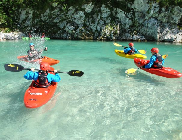 family playing games on kayak school in bovec