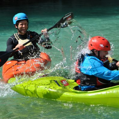 kids are having fun in kayaks on the soča river
