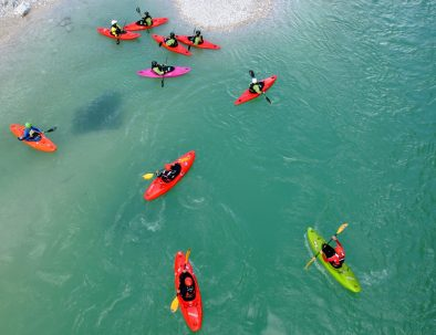 kayakers wondering why is soča river emerald green