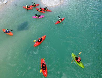kayakers wondering why is soča river emerald green