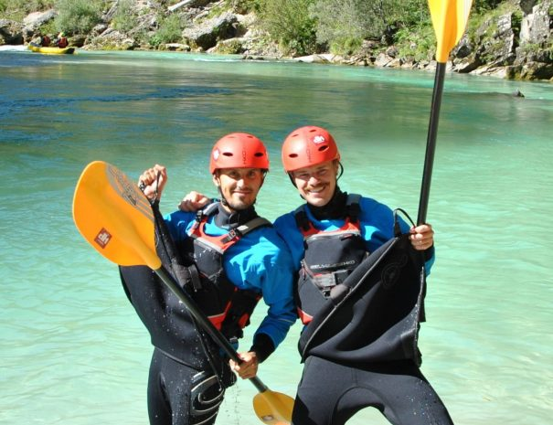 kayakers dancing in paddling gear and having fun in bovec