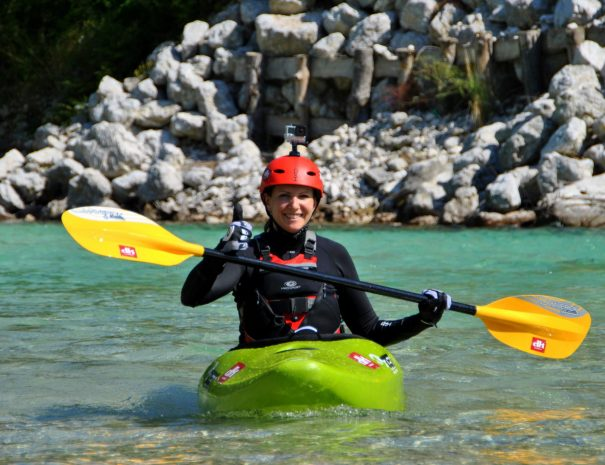 happy female kayaker intermediate kayak course soca river