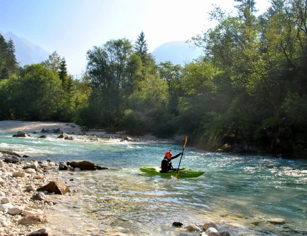 female kayaker in sotočje of soča and koritnica river