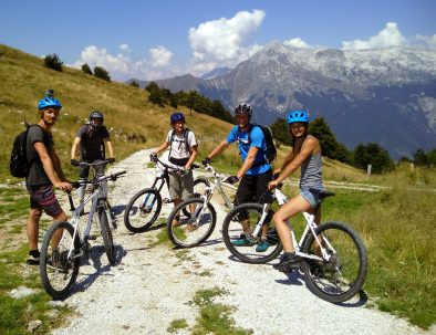 group of friends on guided mtb tour from Stol near bovec