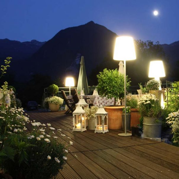 Fine dining experience in beautiful garden overlooking the mountains at Dobra Vila hotel Bovec.